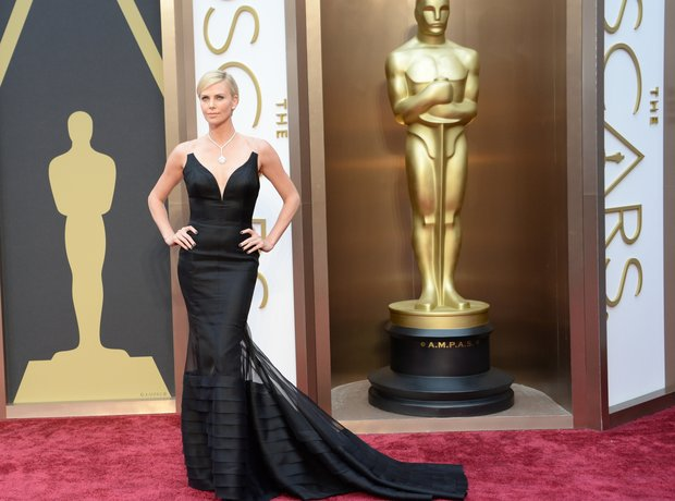 Charlize Theron at the Oscars 2014 red carpet