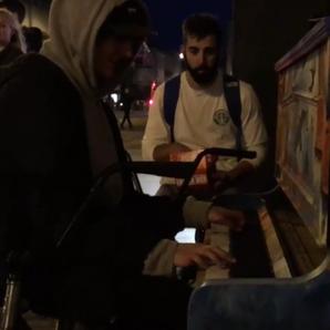 kid playing cheltenham street piano